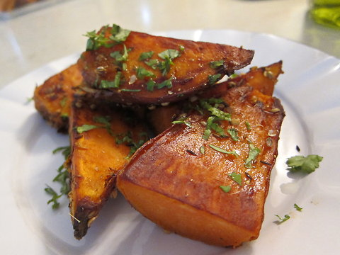 Roasted yams with spice crust.