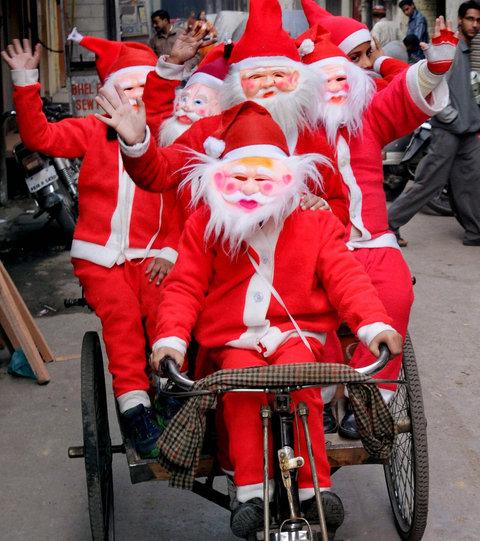 Students dressed as Santa Claus riding a rickshaw in Amritsar, Punjab.