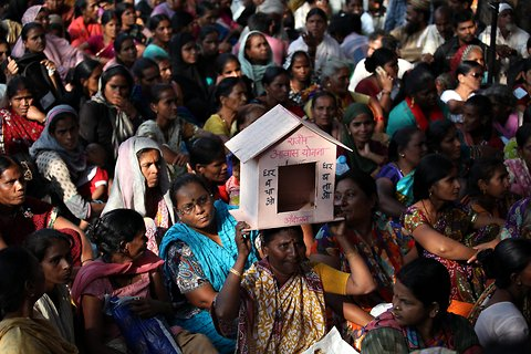 Slum dwellers from different parts of Mumbai, during a march to draw attention to the housing problems faced by the urban poor in the city.