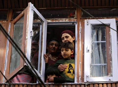 People watching a protest in Srinagar, Jammu and Kashmir. The protest was organized by a separatist group, Jammu and Kashmir Liberation Front, against what they claimed were harsh sentences awarded to Kashmiri youth, local media reported.