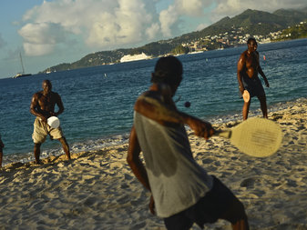 Local men play paddleball on Grand Anse Beach in St. George's, Grenada.