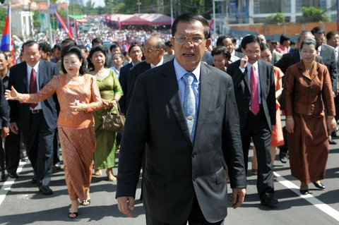 Prime Minister Hun Sen of Cambodia, center, walked ahead of government officials during an inauguration ceremony for a road in Phnom Penh in June 2010.
