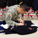 Staff Sergeant Miguel Deynes, 35, at the Dover Port Mortuary, prepared the uniform of Captain Aaron Blanchard, an Army pilot killed in Afghanistan last month.