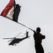 An Egyptian flag was waved as an army helicopter flew over Tahrir Square on Friday. President Obama's decision to go golfing on Friday angered some Egyptians.
