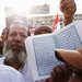 A supporter of President Mohamed Morsi holding up the Koran at a mosque in the Nasr City district in Cairo on Monday.