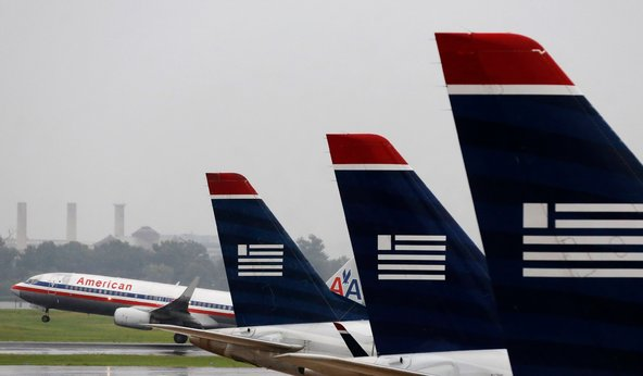 The Justice Department opposes the merger of American Airlines with US Airways, fearing higher fees for fliers with diminished competition.