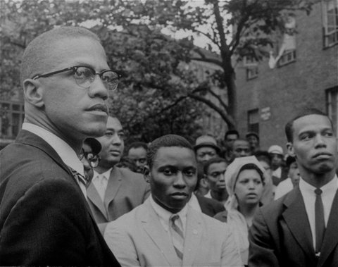 Malcolm X, the former Nation of Islam leader, left, at a rally at Lennox Avenue in Harlem, New York in 1963.
