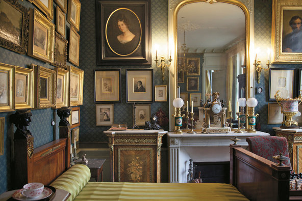 The walls of the Moreau's bedroom are lined with family portraits, including one of Moreau by Edgar Degas.