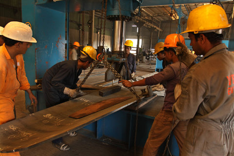 Workers at the Western Marine shipyard in Chittagong