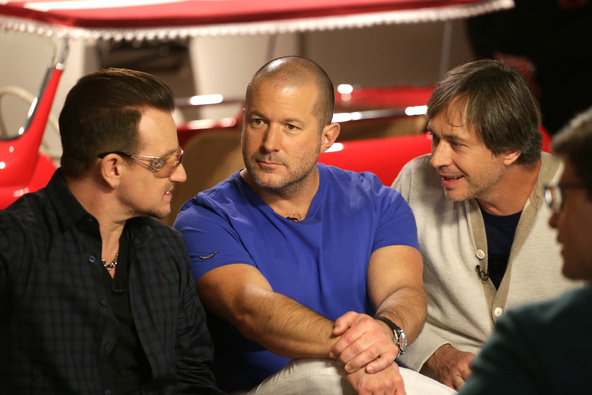 "Jonathan Ive, center, Apple's design chief, on the set of ""Good Morning America"" last year with Bono, left, of the music group U2."