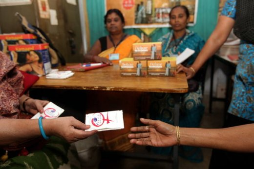 A sex worker receiving a condom at a health clinic in Sonagachi, in the eastern Indian state of West Bengal. The head of the National AIDS Control Organization said condom promotion had been directed at high-risk groups.