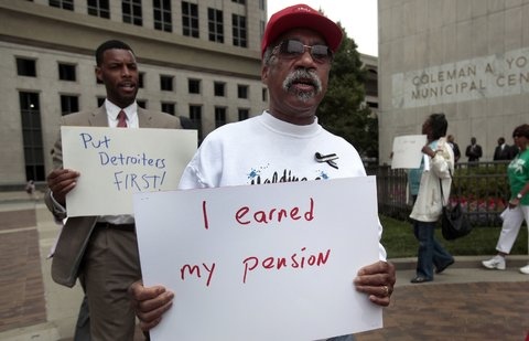 "As part of the ""grand bargain,"" retired workers in Detroit accepted reductions to their monthly checks and other cutbacks."