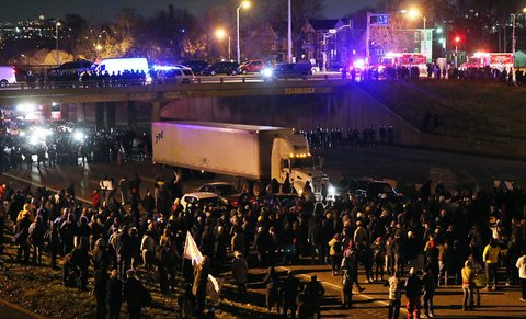 Protesters shut down Interstate 44 at Grand Avenue in both directions in St. Louis on Monday.