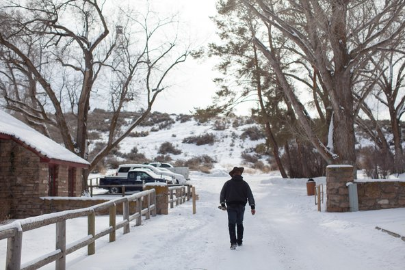 A member of an armed antigovernment protest group walked down a road on Monday at the Malheur National Wildlife Refuge Headquarters near Burns, Ore.