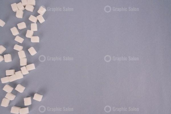 Sugar cubes on grey background stock photo