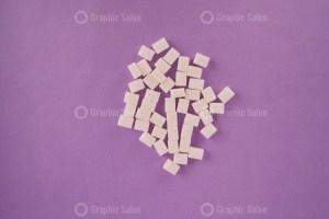Sugar cubes on purple background stock photo