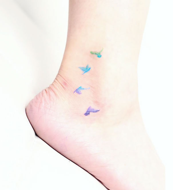 20-tattoo-ideas-for-happy-feet-19