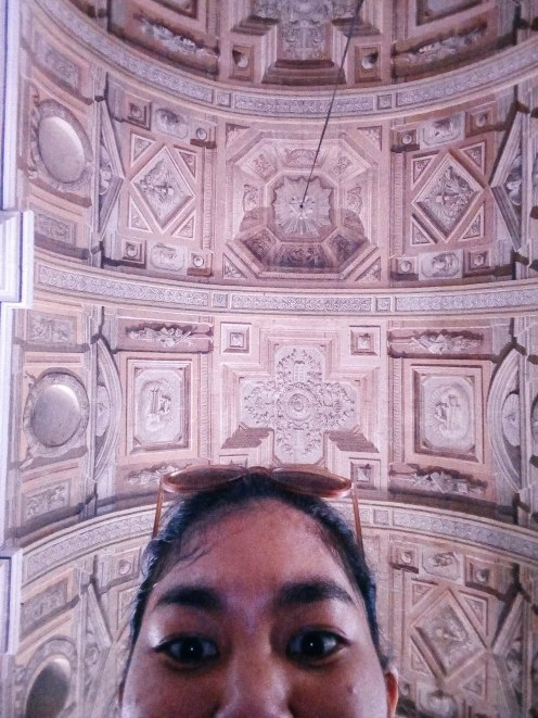 A peek of how amazing the church's trompe l'oeil ceiling is.