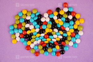 Colorful candy isolated on purple background stock photo