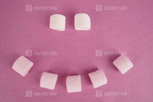 Emoji from sweet marshmallow on purple background