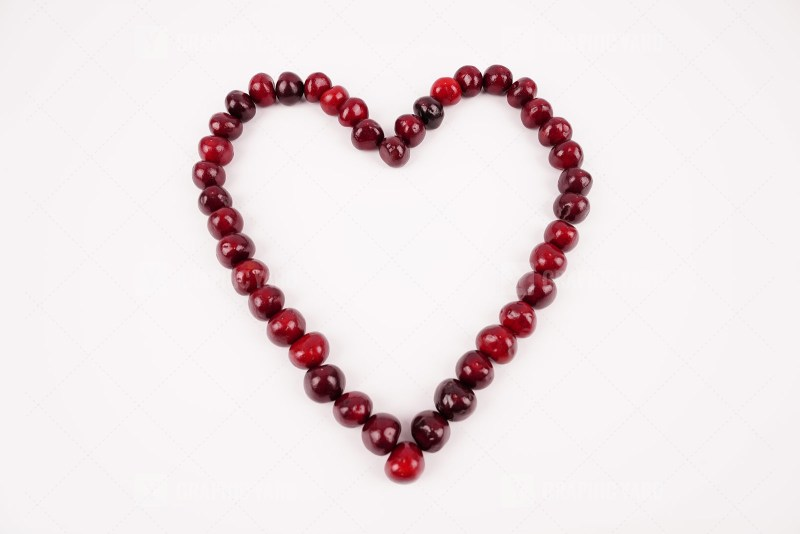 Heart shape with cherries stock photo