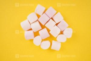 Marshmallows on yellow background stock photo