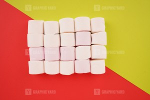 Stack of marshmallow on colorful background stock image