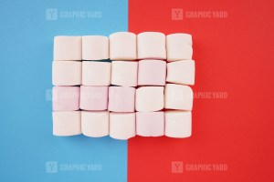 Stack of marshmallow on colorful background stock photo
