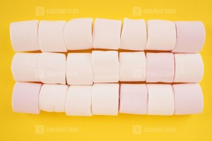 Stack of marshmallow on yellow background stock image