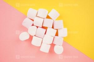 Tasty Marshmallows on colorful background stock photo