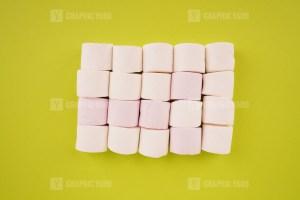 White marshmallow on green background