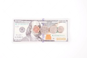 Coins on dollar banknotes
