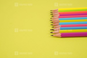 Drawing Pencils on Bright Green