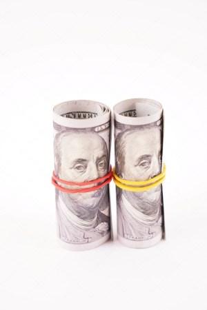 Rolled dollar bills stock photo