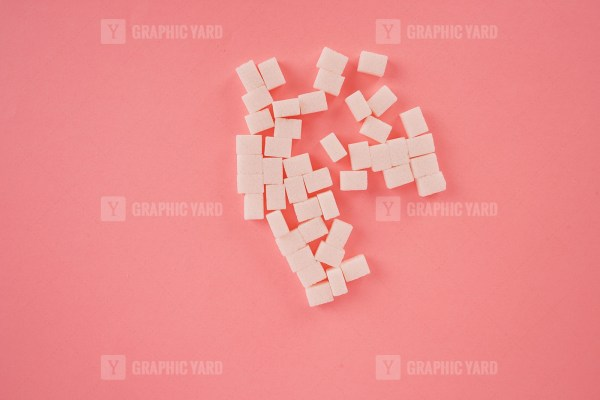 Sugar cubes on bright pink stock image