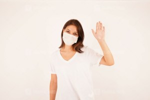 Beautiful girl wearing medical mask