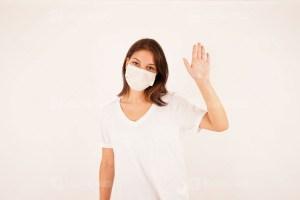 Beautiful girl wearing medical mask