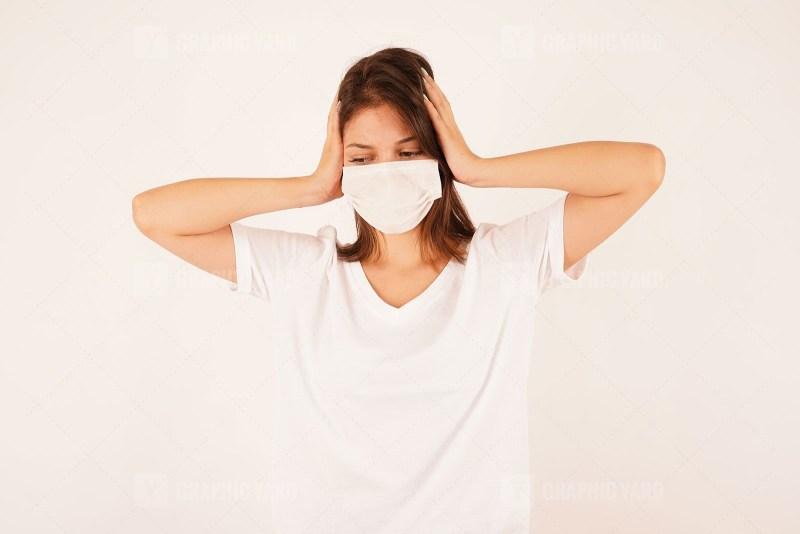 Depressed woman wearing medical mask