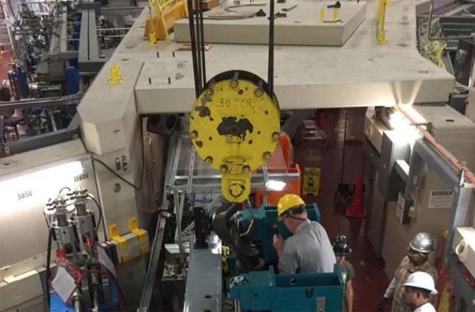 Workers install COSMIC's undulator at Berkeley Lab's Advanced Light Source. Credit: Berkeley Lab