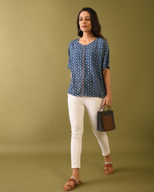 Model wearing Natural indigo dyed dabu print top carrying bag