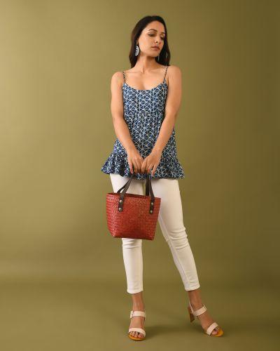 Woman wearing Natural indigo dyed dabu print top holding bag