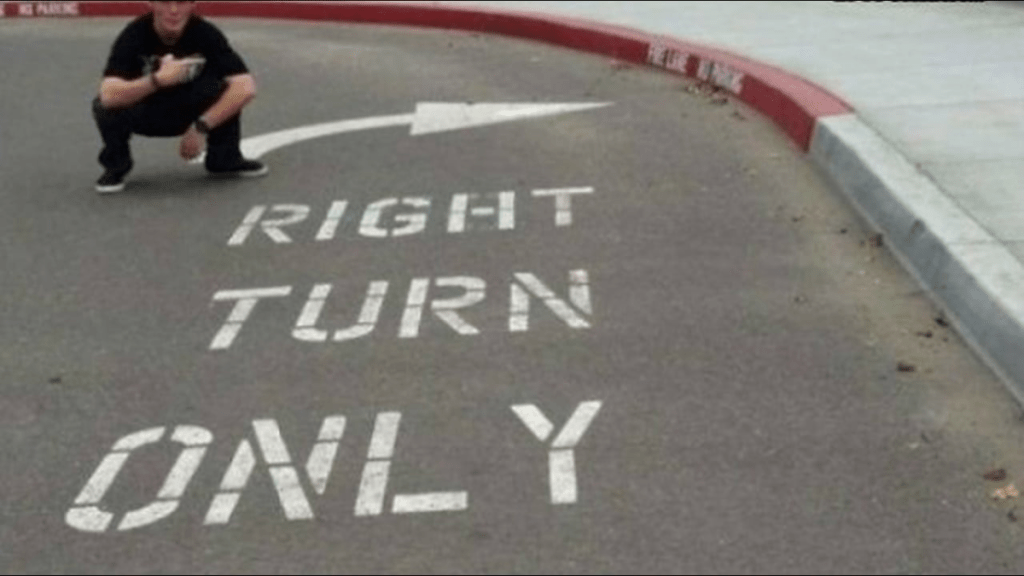 Painted pavement that reads, Right turn only, but you can't turn right.