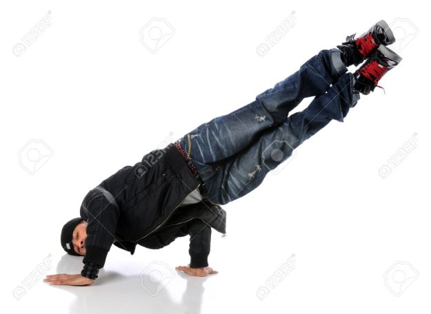 7887752-Africna-American-hip-hop-dancer-performing-a-side-hand-and-head-stand-Stock-Photo