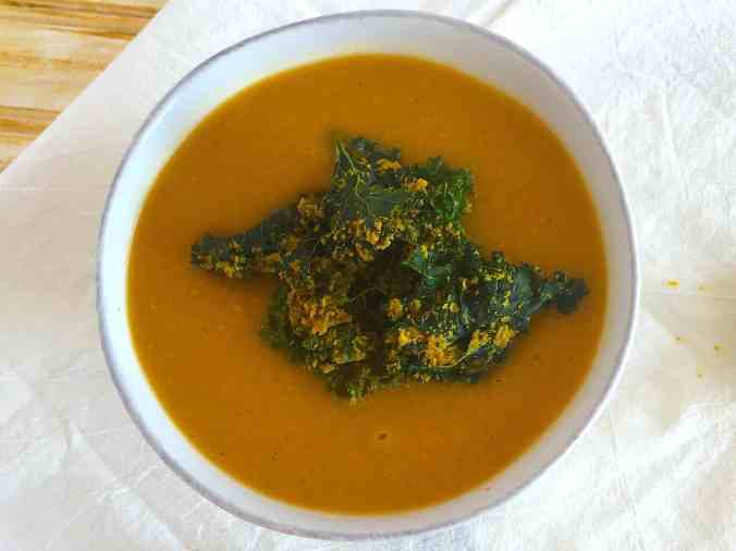 Butternut squash soup with curried kale chips - the perfect healthy and plant-based holiday/Thanksgiving recipe from The Grateful Grazer.
