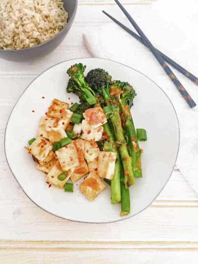 Dry Fried Tofu with Broccolini and Thai Peanut Sauce. This recipe is perfect for healthy and vegan weeknight dinners! Recipe via www.gratefulgrazer.com