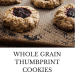 These delicious whole grain thumbprint cookies are healthy enough for breakfast + sweet enough for dessert. Great healthy addition to your holiday cookie tray!