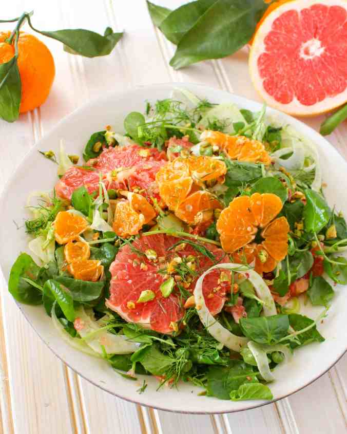Winter Citrus Salad recipe made with grapefruit, satsuma orange, watercress, fennel, and topped with pistachios. Vegan and gluten free. The Grateful Grazer