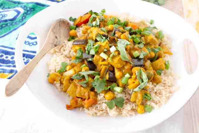 This Roasted Eggplant Chickpea Curry is quick, healthy, and vegan. Created by The Grateful Grazer.