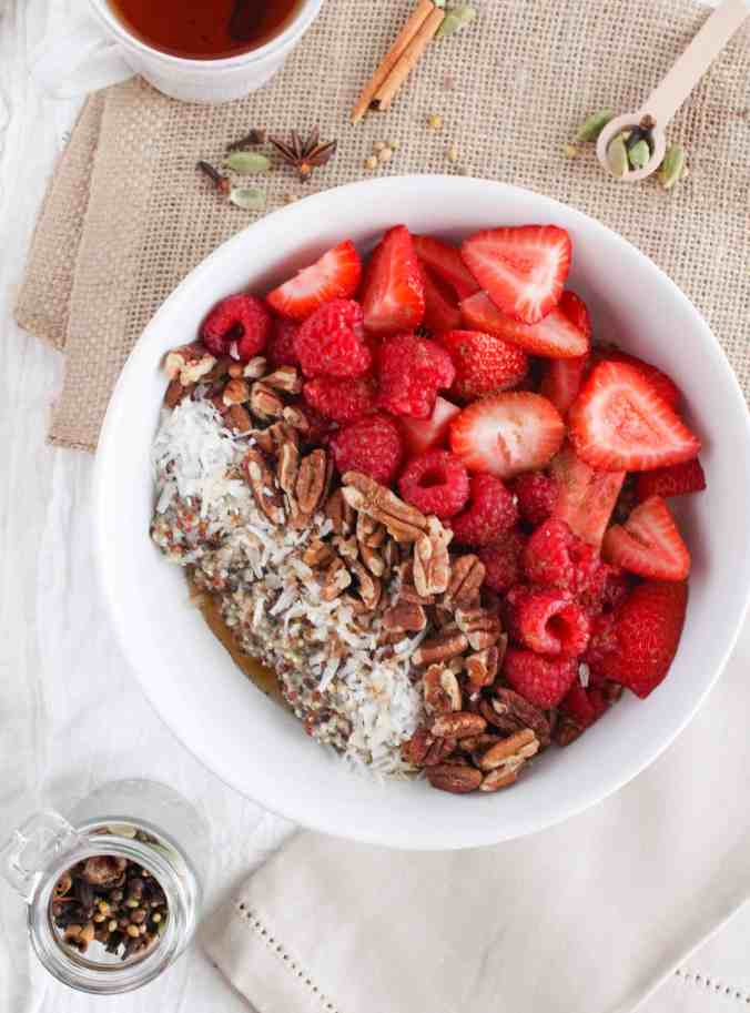 Vegan chai quinoa breakfast bowl with fresh berries from The Grateful Grazer.