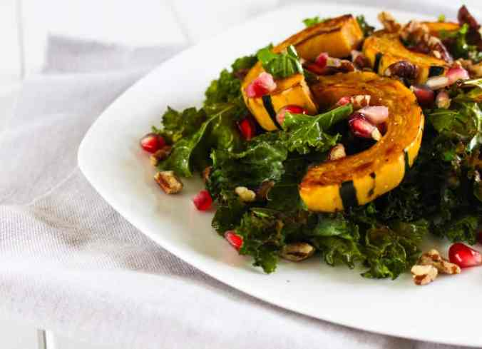 Autumn produce and the best healthy seasonal recipes for fall, including this Warm Kale Salad with Delicata Squash and Pomegranate
